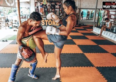 muay-thai-intense-private-training-session-girl-kneeing